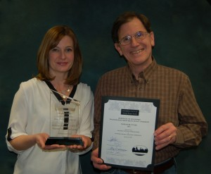 Michele Braas, project manager (left) and Dennis Hammaker, senior engineer, pose with the award