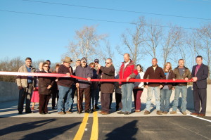 Newville Road Bridge Ribbon Cutting with Township supervisors, local businesses, legislative representatives, and community members.