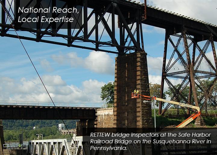 RETTEW bridge engineers inspect a railroad trestle bridge