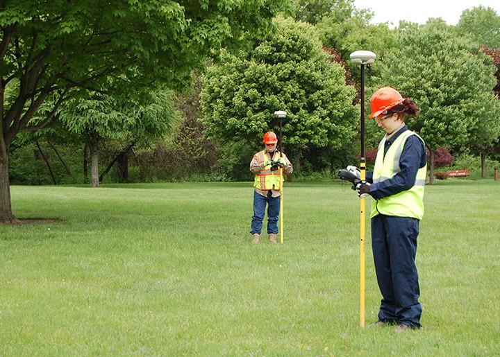 Surveyors using equipment