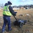 A damage prevention specialist stays warm while finding underground utilities